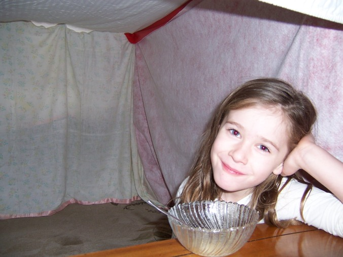 Abigail surviving the ice storm eating snow cream in her tentQ